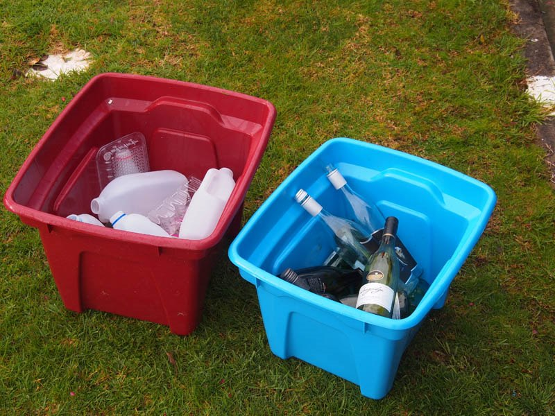 Red and blue recycling bins provided for kerbside collection.